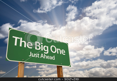 The Big One Green Road Sign stock photo, The Big One Green Road Sign Against Dramatic Sky, Clouds and Sunburst. by Andy Dean