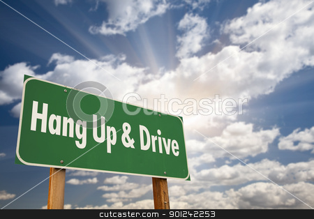 Hang Up and Drive Green Road Sign stock photo, Hang Up and Drive Green Road Sign with Dramatic Sky, Clouds and Sun. by Andy Dean