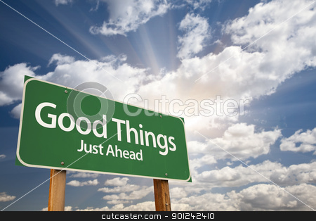Good Things Green Road Sign stock photo, Good Things, Just Ahead Green Road Sign Over Dramatic Sky, Clouds and Sunburst. by Andy Dean