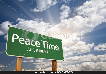 Peace Time Green Road Sign stock photo, Peace Time, Just Ahead Green Road Sign Over Dramatic Sky, Clouds and Sunburst. by Andy Dean