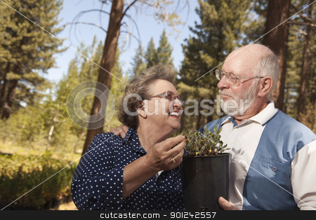 Attractive Senior Couple Overlooking Potted Plants stock photo, Attractive Senior Couple Overlooking Potted Plants at the Nursery. by Andy Dean