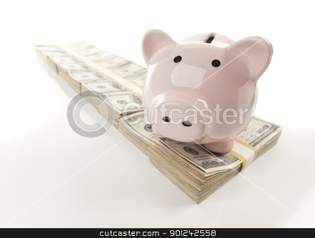 Pink Piggy Bank on Row of Money stock photo, Pink Piggy Bank on Row of Hundreds of Dollars Stacks Isolated on a White Background. by Andy Dean