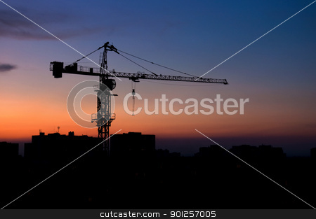Urban building scene stock photo, Building crane on a background of a picturesque sunset by Imaster