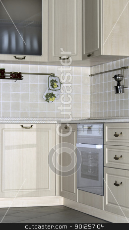Kitchen interior stock photo, Bright interior with kitchen cabinets and wall tiles by Imaster