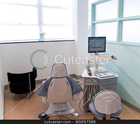 Dental station stock photo, Bright dental chair and exam station. by Cora Reed