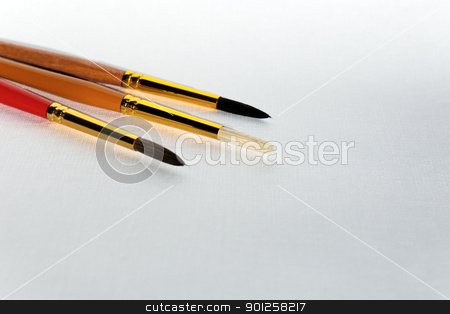 Brushes on a paper stock photo, Brushes on a textured paper for your artistic project by Imaster