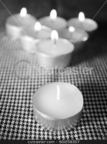 Advantage of one candle stock photo, The group candles is built in a triangle and burn all but one by Imaster