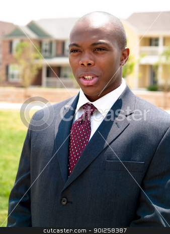 Happy man stock photo, Happy man in a suit in a residential area. by Cora Reed