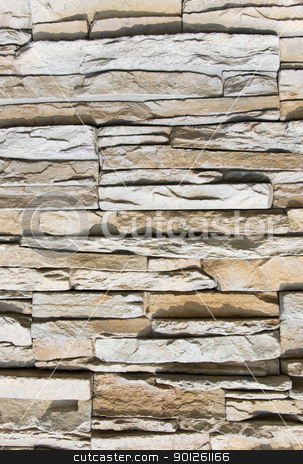 Stone wall stock photo, Fragment of a stone wall close up by Imaster
