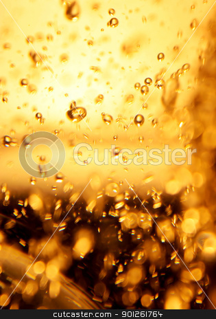 Champagne bubbles stock photo, Abstract macro background of effervescing golden champagne bubbles. by Imaster