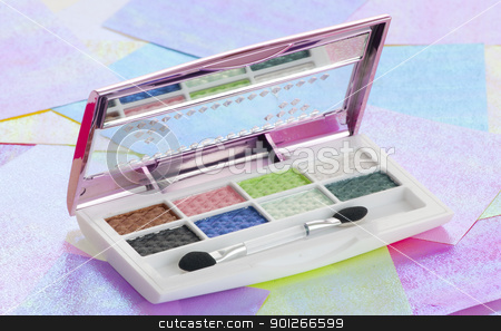 Eye shadow stock photo, Eye shadow kit over colourful papaers background by elemery