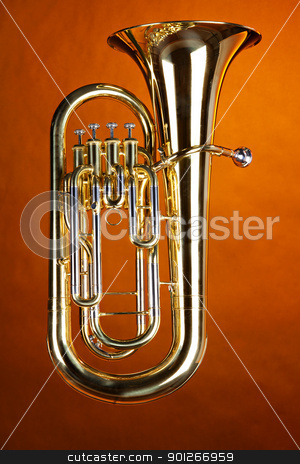 Complete Tuba Euphonium Isolated stock photo, A complete gold brass tuba euphonium isolated against a spotlight gold background. by Mac Milleer  (mkm3)