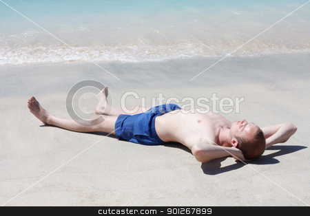 Man relaxing on beach stock photo, Man relaxing on beach by Lasse Kristensen@gmail.com