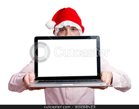 Businessman with santa hat stock photo, Businessman with santa hat and computer by Lasse Kristensen@gmail.com