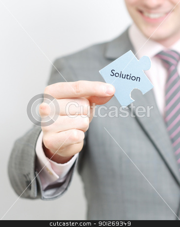 The missing piece stock photo, A business man solving a puzzle by Lasse Kristensen@gmail.com