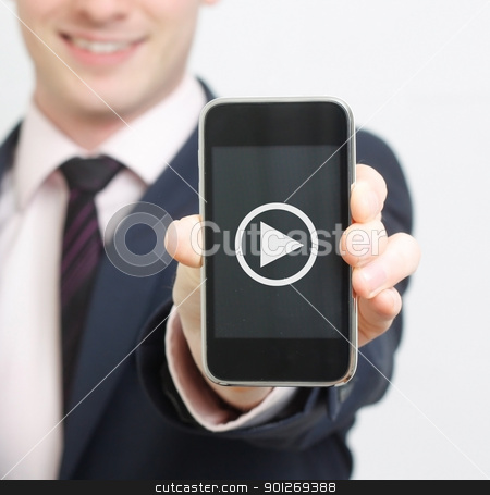 Business man stock photo, A business man showing his phone with video button by Lasse Kristensen@gmail.com