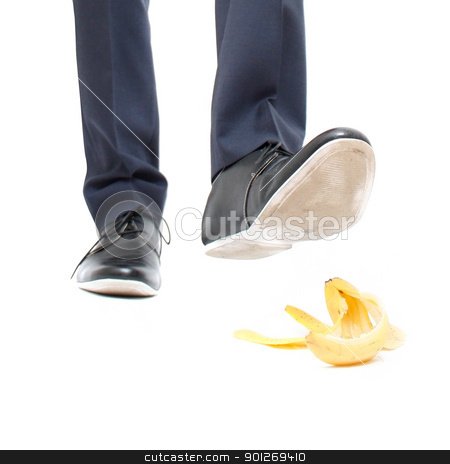 Conceptual danger stock photo, A banana peel and a man about to step in it by Lasse Kristensen@gmail.com