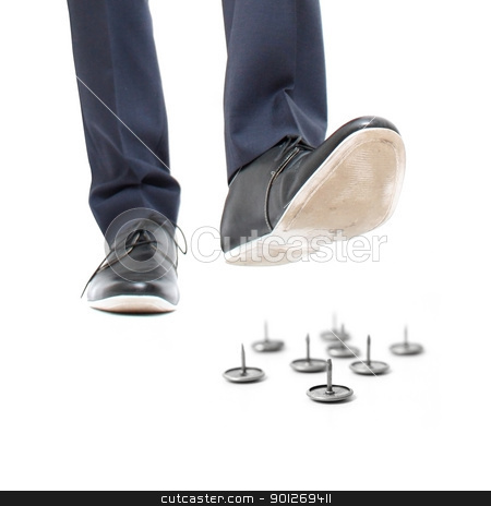 Danger stock photo, A businessman about to step on needles by Lasse Kristensen@gmail.com