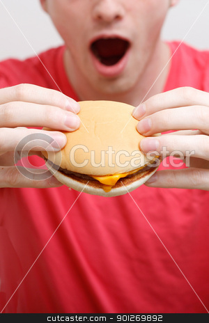 Man eating burger stock photo, A man eating a burger by Lasse Kristensen@gmail.com