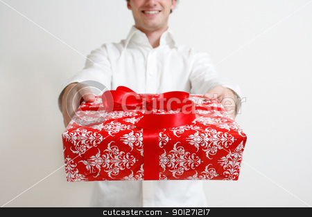 Presenting a gift stock photo, A man presenting a christmas present by Lasse Kristensen@gmail.com