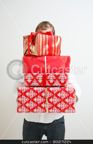 Presenting alot of gifts stock photo, A man presenting several christmas presents by Lasse Kristensen@gmail.com