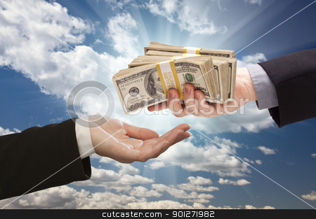 Handing Over Cash with Dramatic Clouds and Sky stock photo, Handing Over Cash with Dramatic Clouds and Sky Background. by Andy Dean