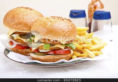 Juicy huge chicken scallop burger stock photo, two Juicy huge chicken scallop burger on white background by Zaid Saadallah