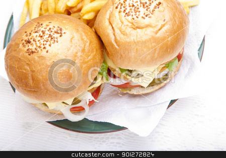 Top horizontal close-up on chicken scallop burger stock photo, Horizontal close-up from top on juicy huge chicken scallop burger by Zaid Saadallah