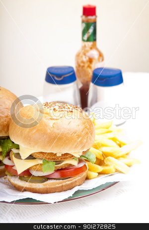 Vertical close-up on chicken scallop burger stock photo, Vertical close-up on juicy huge chicken scallop burger by Zaid Saadallah