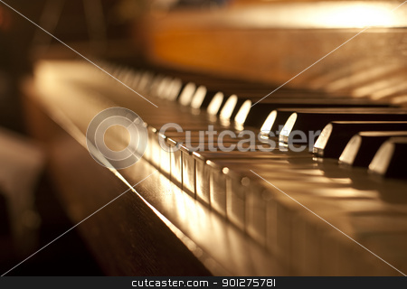Piano keys stock photo, Piano keys on an antique piano played by The Buena Vista Social Club of Cuba by Christian Delbert