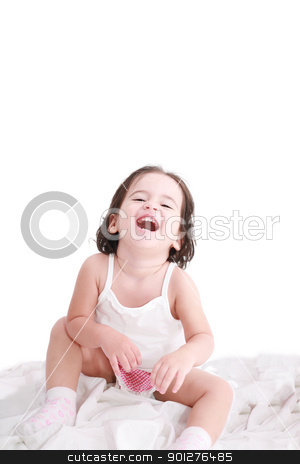 laughing little girl on her bed stock photo, laughing little girl on her bed by dacasdo