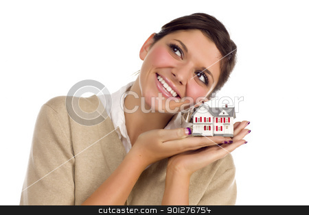 Ethnic Female Daydreaming with Small House on White stock photo, Pretty Smiling Ethnic Female Daydreaming with Small House Isolated on a White Background. by Andy Dean