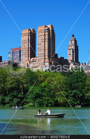 New York City Manhattan stock photo, New York City Central Park with Manhattan skyline skyscrapers and blue sky with boat in lake. by rabbit75_cut