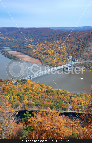 Autumn bridge stock photo, Bear Mountain bridge aerial view in Autumn with colorful trees in forest over Hudson River in New York State. by rabbit75_cut