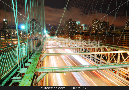 New York City Brooklyn Bridge  stock photo, New York City Brooklyn Bridge with busy traffic light trail and Manhattan skyline at night.  by rabbit75_cut