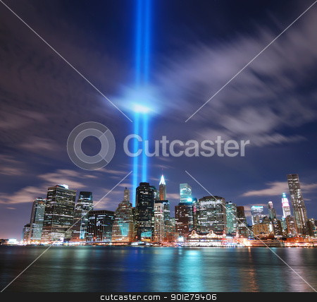 New York City Manhattan skyline  stock photo, Remember September 11. New York City Manhattan panorama view at night with office building skyscrapers skyline illuminated over Hudson River and two light beam in memory of September 11. by rabbit75_cut