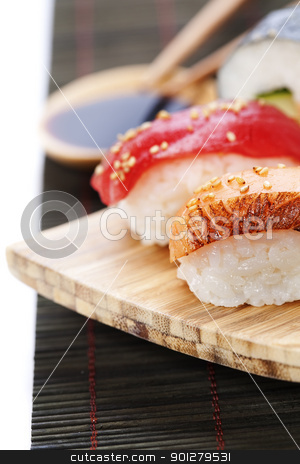 sushi stock photo, set of japanese sushi with chopsticks and soy sause over white