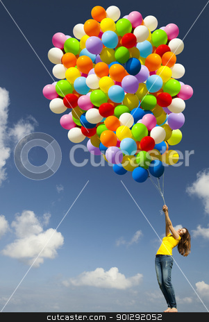 Girl with colorful balloons stock photo, Happy young woman with colorful balloons on a green meadow by ikostudio