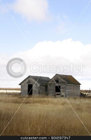 Weathered Grain Bins stock photo, Two wooden grain bins stand weathered on the saskatchewan prairie by Tyler Olson