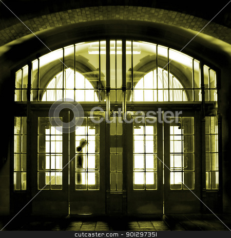 Man Standing in Doorway stock photo, A man standing in an old gothic architectural doorway by Tyler Olson