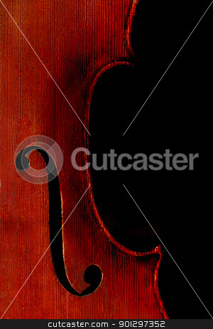 Cello isolated on Black stock photo, A cello with rich wood texture isolated on a black background by Tyler Olson