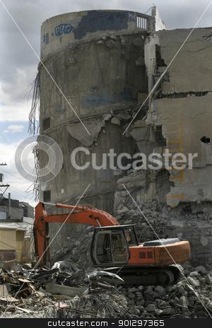 Destruction of a Parkade stock photo, A backhoe is tearing down a concrete parkade in Saskatoon, Saskatchewan by Tyler Olson