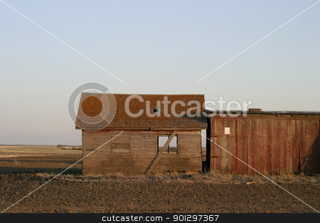 Old Abandoned Farm Granery stock photo, Abandoned buildings on the prairie by Tyler Olson