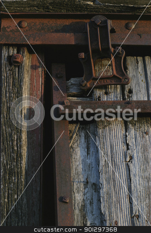 Rusted Sliding Door stock photo, Old hanging door rusted and weathered by Tyler Olson