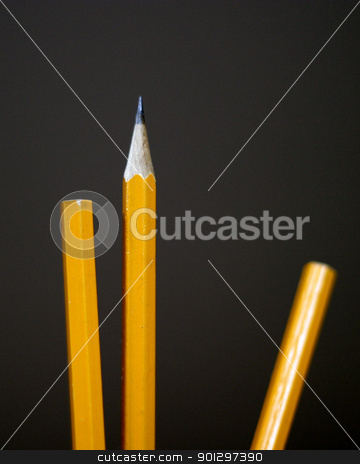 Pencil Concept stock photo, Three pencils lined up with one sharpened on a black background by Tyler Olson