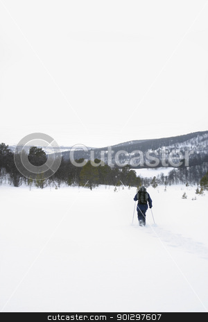 Mountain Skiing stock photo, Skiing in the Mountains accross a lake by Tyler Olson