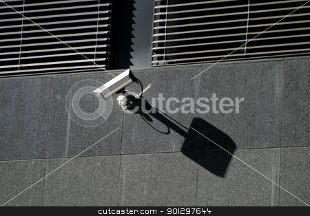 Security Camera stock photo, Security Camera on a stone wall by Tyler Olson