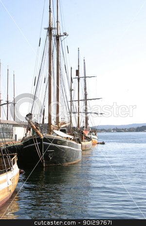 Old Wooden Sailing Ships stock photo, Sailing ships at dock in the Oslo Harbor by Tyler Olson