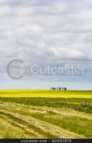 Prairie Landscape stock photo, Prairie Landscape with some old granaries in the distance. by Tyler Olson