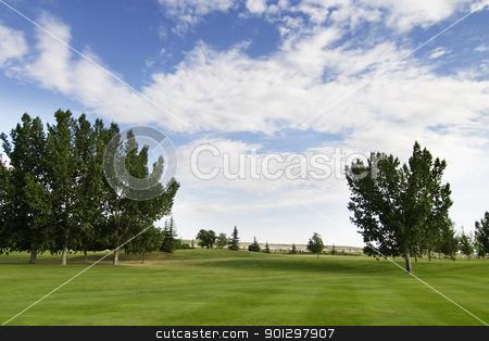 Saskatchewan Golf stock photo, Saskatchewan golf course with vivid blue sky by Tyler Olson